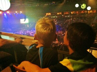 two boys watch concert