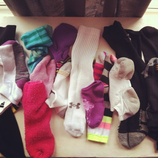 Several single socks on table.